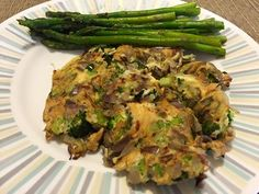 Hearty omelette with lots of veggies - broccoli, onions, mushroom and cilantro- with a side of roasted asparagus with desi spices