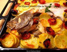 Rombo al forno con patate e pomodori confit