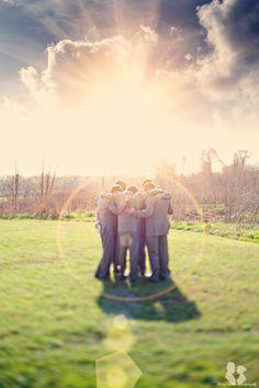 Groomsmen with sun flare