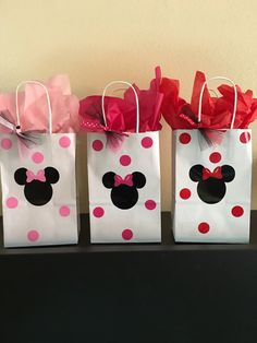 These bags are great for any mouse inspired party. Each bag measures 5.5X3.25X8 inches. They each come decorated with vinyl stickers and sturdy