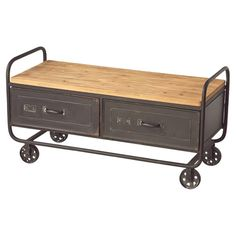 Bring industrial-inspired style home with this wood-topped metal coffee table, featuring a vintaged cart-style design.     Product: