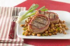 Thick, juicy pork medallions accompanies chili-spiced black-eyed peas. For a truly delightful meal, try pairing Chef Evans' signature pork dish with