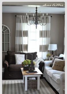Beautiful grey and brown decor.  Loving the grey curtains.