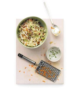 Sweet-and-Spicy Coleslaw | Martha Stewart Living - No backyard cookout is complete without slaw, and this creamy slaw has a surprising kick that comes from sweet raisins and a jalapeno chile.