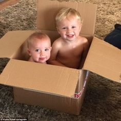 Playtime: Katie Price shared this heartwarming picture of her baby boy Jett, two, (R) and 13-month-old daughter Bunny (L) gazing up at her from within a cardboard box