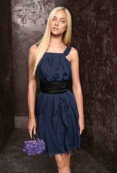 Brides.com: Navy Blue Bridesmaid Dresses. Style VW360101, crinkle chiffon halter dress with mikado sash in midnight, $230, White by Vera Wang available at David's Bridal  See more White by Vera Wang bridesmaid dresses.