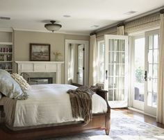 Great bedroom! Perfect size. Some books. French doors. Fireplace. Via Splendid Sass.
