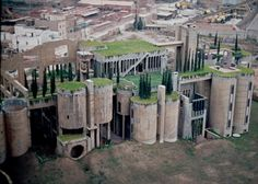 Ricardo Bofill concrete factory residence by architect ricardo bofill. barcelona, spain. the complex includes bofill's offices, archives, a model laboratory, exhibition space, his personal apartment, guest rooms & extensive gardens. the cement factory was originally comprised of 30 silos, gigantic engine rooms & extensive gardens with brutalist & surrealist elements. the lot was planted with beautiful gardens, which include eucalyptus, palm trees, olive trees and cypresses.