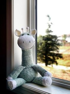 Sock Giraffe.  Like a sock monkey, but even cuter....maybe I can figure out how to make this in time for camp....that is if anyone is interested in making one....