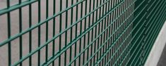 A piece of green PVC coated double wire fences are installed in the factory as security fence.