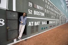 Boston, Ma-Sept. 15, 2016-Globe Staff Photo by Stan Grossfeld- Christian Elias, 44, the Green Monster scoreboard operator at work during a Yankees Red Sox game at Fenway Park.
