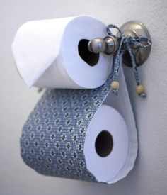 Storing an extra toilet paper roll - make it to make the bathroom decor!