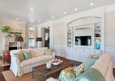 House of Turquoise: Erin Parker - blue and white coastal living room with sisal rug and rustic wood coffee table
