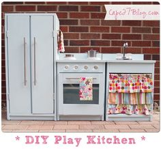 DIY Play Kitchen ~ Glass knobs are darling.