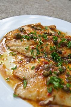 Fish in Caper Lemon Sauce ½ pound of white-fleshed fish – I used 2 big sized tilapia fillets about ¼  cup flour for dredging freshly ground white or black pepper to taste 2-4 tablespoons unsalted butter 2 tablespoons extra virgin olive oil 1 tablespoon small capers, drained ¼ teaspoon of anchovy paste 1 teaspoon of minced garlic ¼ cup dry white wine juice of one lemon 1 teaspoon of chili paste (to give it a bit of a kick!) 2 tablespoons chopped fresh Italian parsley salt n pepper