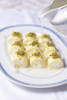 Halawet el jibne - sweet semolina filled with ricotta, drizzled with rose water or orange blossom syrup and dusted with pistachios.