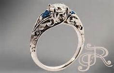 This is the top of my list. Love the simple graceful filigree and the stones.