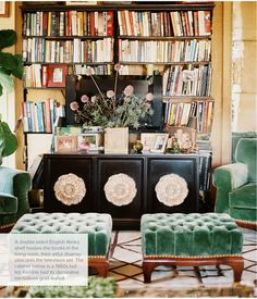 green velvet tufted ottomans and matching chairs + black credenza with gold rosettes (Celerie Kemble via Lonny)