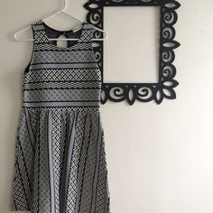"""Cute sun dress with black & white geometric print! This fun dress is fun and easy to style up or down. Pair with a red blazer and heels, or flip flops and a tied chambray shirt and you could be ready to go to work or the beach in a flash!  *tagged Urban Outfitters for exposure; tag reads """"Ginger G"""" Urban Outfitters Dresses"""