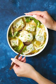 Chicken Wonton Soup - Cozy, comforting wonton soup just like your favorite takeout place! No need to be intimidated here. This recipe is so quick and easy, and the chicken wontons are packed with so much flavor! Nothing beats homemade, right?