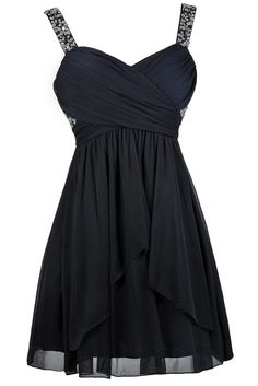 A hint of sparkle at the bust and shoulder straps makes this the perfect navy party dress for any event! The Gleaming Of You Embellished Navy Party Dress is fully lined and made of chiffon. It features fabric that drapes and crosses over at the bust and splits open at the front of the skirt. A hidden layer of tulle under the skirt adds a bit of volume. The best part of this dress has to be the gorgeous blue, silver, and clear sequins, beads, and rhinestones that decorate the shoulder straps…