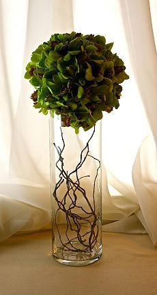 sphere of Dendrobium Orchids sits atop a cylinder filled with Willow branches in a modern centerpiece or accent arrangement Modern Centerpieces, Modern Flower Arrangements, Succulent Centerpieces, Vase Arrangements, Cylinder Centerpieces, Centrepieces, Ikebana, Fresh Flowers, Beautiful Flowers