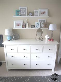 IKEA shelves above dresser - love the cluster of frames, etc