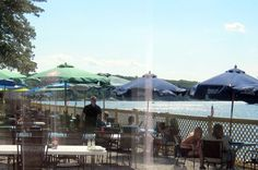 LakeView Restaurant (also known as LakeSide Cafe & Lounge) has this outdoor deck overlooking Coventry Lake.  Refreshing breezes coming in from over the water.  Photo taken thru the window of the new expansion.