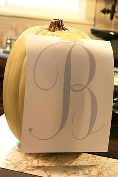 How To Monogram A Faux Pumpkin: Pumpkin Cream/Ivory Spray Paint (Flat or Satin), Masking or Painters Tape, Transfer/Graphite Paper, Acrylic Paint, and Paintbrush. Fall Crafts, Holiday Crafts, Holiday Fun, Holiday Ideas, Festive, Diy Crafts, Halloween Pumpkins, Halloween Crafts, Halloween Decorations
