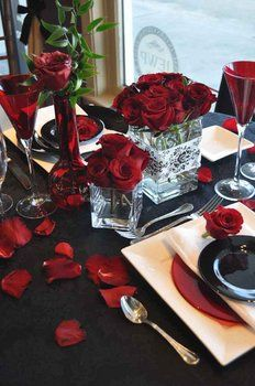 Black white and red wedding table setup.