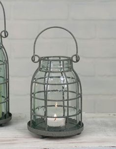 x Includes a midget pint glass chimney. The cage and chimney lift off the base to allow you to replace the candle. Holds a tea light candle, not included. Mason Jar Candle Holders, Hanging Mason Jars, Mason Jar Candles, Mason Jar Lamp, Manson Jar, Galaxy Bath Bombs, Pint Mason Jars, Candle Lanterns, A Table