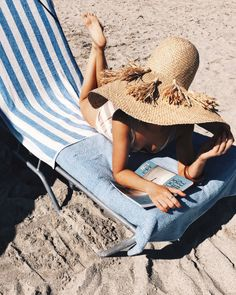 Striped sun loungers and oversized straw hats - beach life