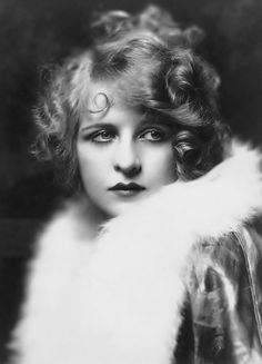 When looking at black and white photographs of women considered glamorous in the 1920s and early 20th century, I often find it difficult to relate to their look. Their make-up is strange and melodramatic, their hairstyles usually unflattering and even macabre; almost like there was a preference for