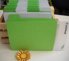Great idea to store your Embossing folders and see what pattern is quickly. You can even demo on cards before hand... time saver :)