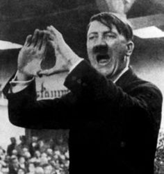 Adolf Hitler, although a treacherously evil man, was also a highly educated articulate man who was fascinated by the occult philosophical doctrines of Aleister Crowley's Ordo Templi Orientis among many other esoteric mystery religions. Aleister Crowley would ultimately work with British intelligence against the Nazi regime in his old age during WW2. This photo shows Hitler displaying the Astrum Argentum grade fire sign which is intended to represent masculine energy, power and dominance.
