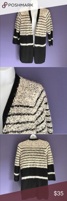 """Calvin Klein Black & White Striped Cardigan This cozy and cute cardigan I perfect for any occasion. Pair with jeans or leggings.  Measurements (Flat):  Length - 33""""/Bust - 27""""/Waist - 27"""" Calvin Klein Sweaters Cardigans"""