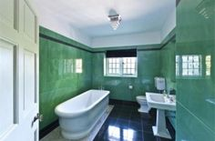 Adele's Bathroom - #Adele moved into her new mansion in early 2012, featuring 10 bedrooms, 2 swimming pools, and a helicopter hanger! Although not the master bathroom, this turquoise bathroom looks fit for a long soak in the traditional tub.