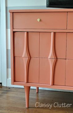 Coral and Gold the Perfect color combo. And this Dresser is a dream!