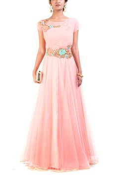 Featuring a floral peach puff gown. The yoke has beautiful rose embroidery done using sequins and thread work.
