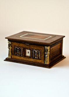 Miniature bible box with secret compartment.