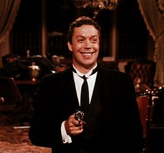 Clue: The Movie Tim Curry as Wadsworth  Why he is rely smiling: Finally a movie where the women wear more makeup then me!
