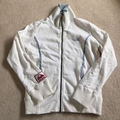 The North Face Sapporo Jacket Brand new The North Face jacket.  It has decorative stitching on both sleeves. The North Face Jackets & Coats