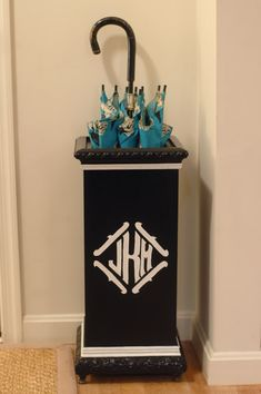monogrammed umbrella stand    We can apply / cut a vinyl monogram for your umbrella stand at Kathy's Kreations. How cute!!!    @Kathy Hall #kathyskreations http://www.facebook.com/pages/Kathys-Kreations/224884085166