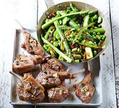 Marinate lamb with rosemary, then serve with an asparagus, broad bean and spinach salad with juicy sultanas and tangy shallots