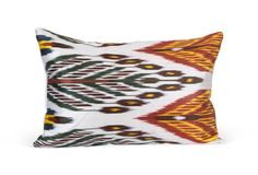 """Cotton and silk ikat pillow from Uzbekistan made in the traditional tie-dye and woven pattern; 90/10 feather/down fill; 12""""L x 18""""W"""