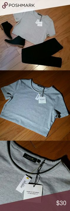 "KATE SPADE SATURDAY GRAY CROPPED KNIT TOP Kate Spade Saturday gray, cropped, knit top. Feels like a soft, smooth, lightweight sweater.  100% cotton  Size Medium Armpit to armpit 18"" across laying flat  Shoulder to hem 16.5""  New with tags kate spade Tops Crop Tops"