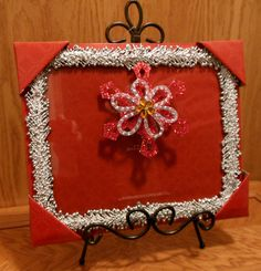 Lovely silver picture frame with easel and red/silver snowflake ornament