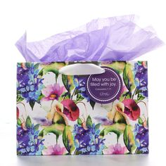 """Gift Bag, Small Horizontal Seeds of Love  May You Be Filled With Joy  Purple Colossians 1:11  Gift bag for any occasion with satin ribbon handles with gift tag that says May you be filled with joy.   Colossians 1:11; includes 1 sheet of tissue paper; 9"""" x 6.25"""" x 4"""".   Size: 23 x 10 x 16 cm  PRICE: R30 per Bag."""