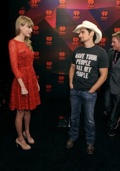 Taylor Swift Photos Photos - (L-R) Musicians Taylor Swift and Brad Paisley in the Elvis Duran Broadcast Room during the 2012 iHeartRadio Music Festival at the MGM Grand Garden Arena on September 22, 2012 in Las Vegas, Nevada. - 2012 iHeartRadio Music Festival - Day 2 - Elvis Duran Broadcast Room