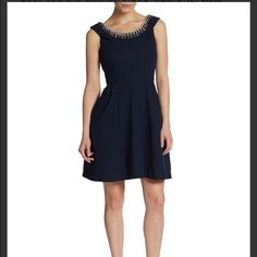 "Betsey Johnson Fit & flare Dress. Retail $169 NWT, never tried on .  Dress is navy.  Sold out and hard to find. Oh, it has POCKETS!  Jewels trace the neckline of this swishy fit-and-flare dress. Embellished neckline. Sleeveless. Cut-in shoulders. Seamed waist. On-seam pockets. Concealed back zipper with hook-and-eye closure. Lined. About 35"" from shoulder to hem.   Lined: Yes Material: 100% Polyester Zipper: Back Zipper  Measurements: 37 inches Total Length 28 inches Bust Around 28 inches…"